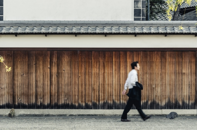 Man walking through bikan district